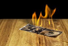 Money on fire. This is a bank note getting fire Royalty Free Stock Image