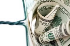 Money in fishing net. One hundred dollar bills in fishing net royalty free stock photography