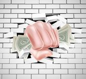 Money Fist Punching Through White Brick Wall Stock Photos