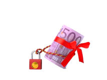 Money five hundred euros on the castle. Money five hundred euros rolled in a tube with a red bow tied to the red castle red cord on a white background and tilted Royalty Free Stock Photo