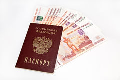 Money. Five-thousandth banknotes of Russia, lying in the passport, on a white background Stock Image