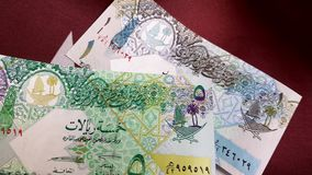 Money on Flag Of Qatar. Banknotes on Flag Of Qatar dolly shot stock video footage