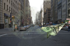 Money floating. Dollar bill floating in front of image of NYC street Royalty Free Stock Photos