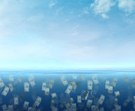 Money floating  in the sea Royalty Free Stock Images