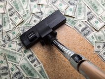 Money on the floor vacuuming with vacuum cleaner Stock Image