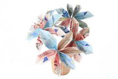 Money flower in a pot. Flower made of money in a pot, isolated Stock Photography