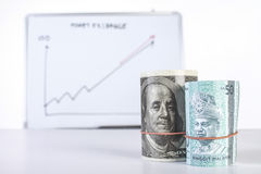 Money with fluctuating chart Royalty Free Stock Images