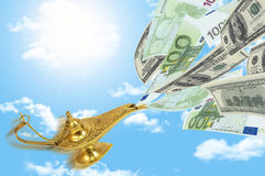 Money fly out of Aladdin's magic lamp. Business concept Stock Photo