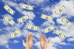 Money fly in sky. Money bills fly in sky and two hands royalty free stock images