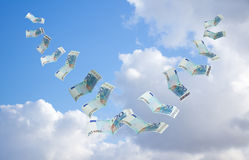 Money flying away. Into the sky Stock Photos