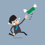 Money is flying away from businessman. Money is flying away from crying businessman Stock Photo