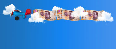 Money flying high in the sky Royalty Free Stock Image