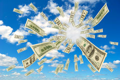 Money flying out of the sky. Stock Image