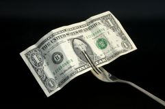 Money for food. A bank note in a metal fork Royalty Free Stock Photo