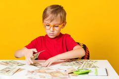 Free Money For Future Education. Cute Boy Acount His Money. Financial Literacy Of Children Royalty Free Stock Photography - 180122427