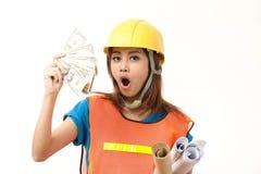 Money. Foremen holding money in success Stock Image