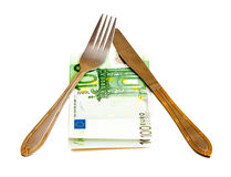 Money with fork and knife Royalty Free Stock Image
