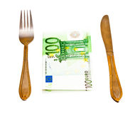 Money with fork and knife Royalty Free Stock Photography