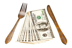 Money with fork and knife Stock Photo