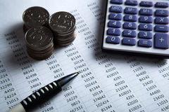 Money in the form of banknotes and coins with calculator Stock Photography