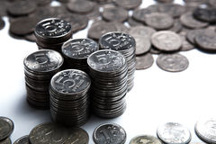 Money in the form of coins on a white Royalty Free Stock Photography