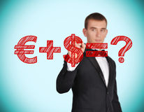 Money formula. Businessman with pen in hand drawing money formula Stock Photos