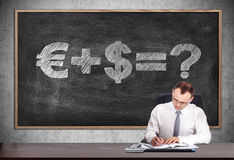 Money formula. Businessman signs a contract and blackboard with drawing money formula Royalty Free Stock Images