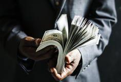 Money fraud holding illegal negative Stock Photo