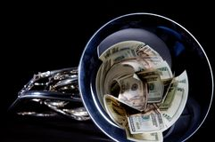 Money in French  Horn Bell Royalty Free Stock Photography
