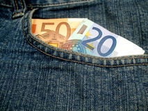 Money in front pocket. A couple of euro banknotes in the front pocket of some jeans Stock Photography