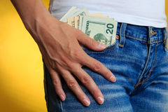 Money in front pocket and women's hand on it Royalty Free Stock Images