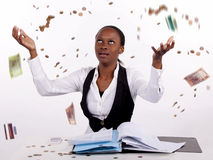 Money Frustration. Woman frustrated with finances throws money and hands in the air Stock Image