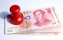 Money gain. A pile of Chinese currency 100 yuan and a  red seal Royalty Free Stock Images