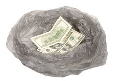 Money in a garbage bag Stock Image