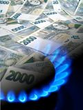 Money and gas burner Stock Image