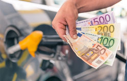 Money at gas station Stock Images