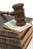 Money and gavel. Law concept with us dollar and old gavel on white Royalty Free Stock Photography