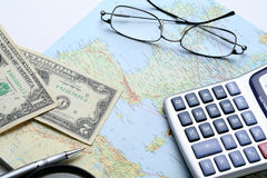 Money and geographical map Stock Photo