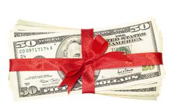 Money gift. American money pack up like gift isolated Stock Photo