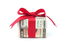 Money gift. Dollar wrapped gift box with a red ribbon bow royalty free stock photos