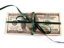 Money gift. One hundred dollar bills wrapped with a green ribbon Royalty Free Stock Photos