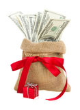 Money in gift bag. With red bow  isolated on white background Royalty Free Stock Images