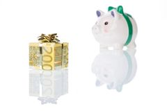 Money gift box of 200 euro with piggy bank. Money gift box of 200 euro and piggy bank isolated on a white background Royalty Free Stock Photo