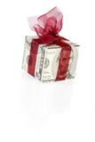 Money gift box of 5 dollar. Money gift box with red ribbon, 5 dollar bill, isolated on a white background Royalty Free Stock Photos