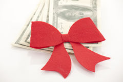 Money, gift wrapped in red bow Royalty Free Stock Image