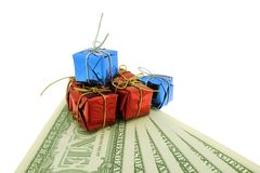 Money  and gifts. One dollar banknotes, white backcloth and gifts Stock Photos