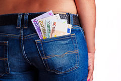 Money in Girls Jeans Back Pocket Stock Image