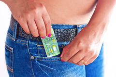 Money in Girls Jeans Front Pocket Royalty Free Stock Photos