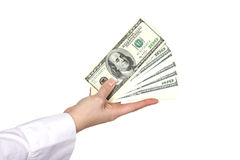 Money in a giving hand Stock Photos