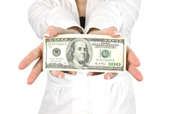 Money in a giving hands Stock Photo